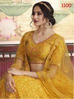 Fein besticktes Lengha Choli Stoffset aus gelbgoldenem Tüll und Seide